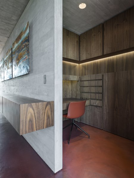 A walnut-clad studio is tucked behind the wall in the living room.