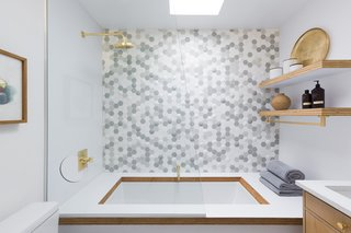 In the shower, handmade Bubble Hex tile from the Futura collection at the Portland–based company Clayhaus Tile makes a stunning statement.
