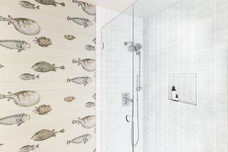 The shower enclosure sports the Disk tile from the Futura collection at Clayhaus.
