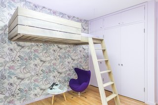 "Horner worked with the client's daughter to maximize a small bedroom and make it her own. ""We worked with her on all the choices—a true collaboration,"" he says. ""[The bunk] allowed her to have more room under the bed to play in what is a tiny room."" The existing closets were kept, just repainted, and the wallpaper is Cole & Son Savuti Ardmore."