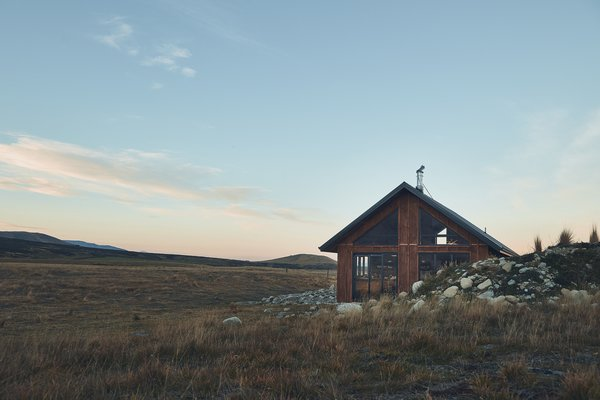 """The couple wanted the cabin to mesh with its beautiful natural surroundings. """"To us this meant small,"""" says Kenny. """"We wanted the design to put you right into the landscape, and by making it small we feel drawled by the night sky and mountains that surround us."""""""