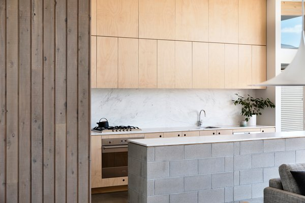 In A Closer View Of The Kitchen, The Counters And Backsplash Are Marble,  Combined
