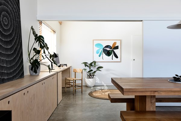 A multipurpose room off the main area has the same plywood cabinetry for a consistent look. The room has sliding doors that can be closed for its use as a fourth bedroom or study, or left open to enlarge the main living area.