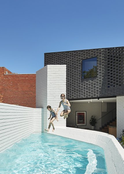 The architects made space for a petite pool in the new private courtyard, with a glimpse of the surrounding industrial buildings in the background.