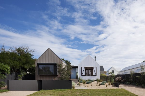 """The gabled forms embrace the context of the surrounding post-war weatherboard houses, and the white polycarbonate directly references the white weatherboards of the dwelling to the north,"" say the architects."