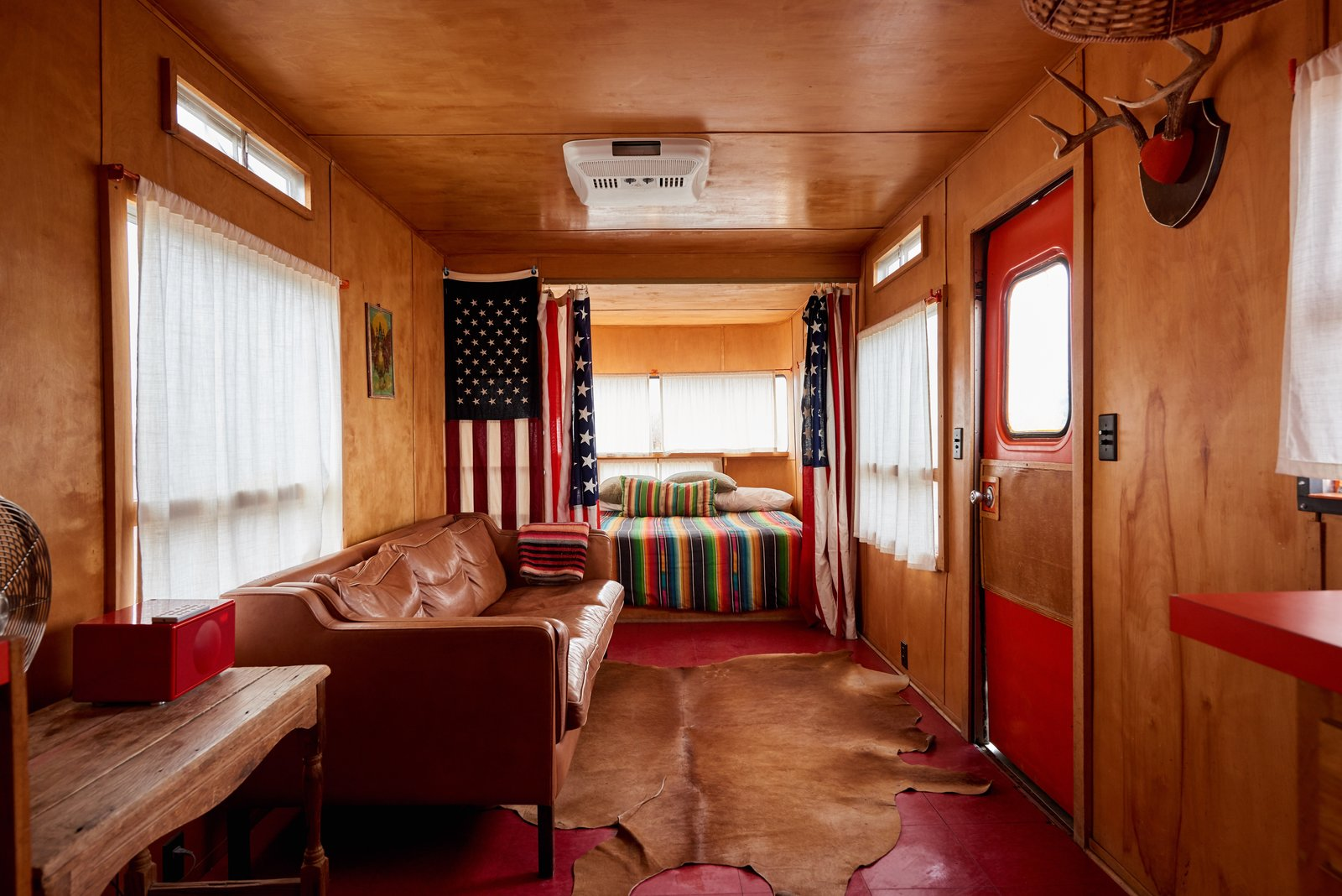 Living Room, Sofa, Rug Floor, and Console Tables Another peek inside a vintage trailer.    Photo 8 of 12 in Let Your Creativity Soar at This Eclectic Hotel With Tents, Tepees, Yurts, and Trailers
