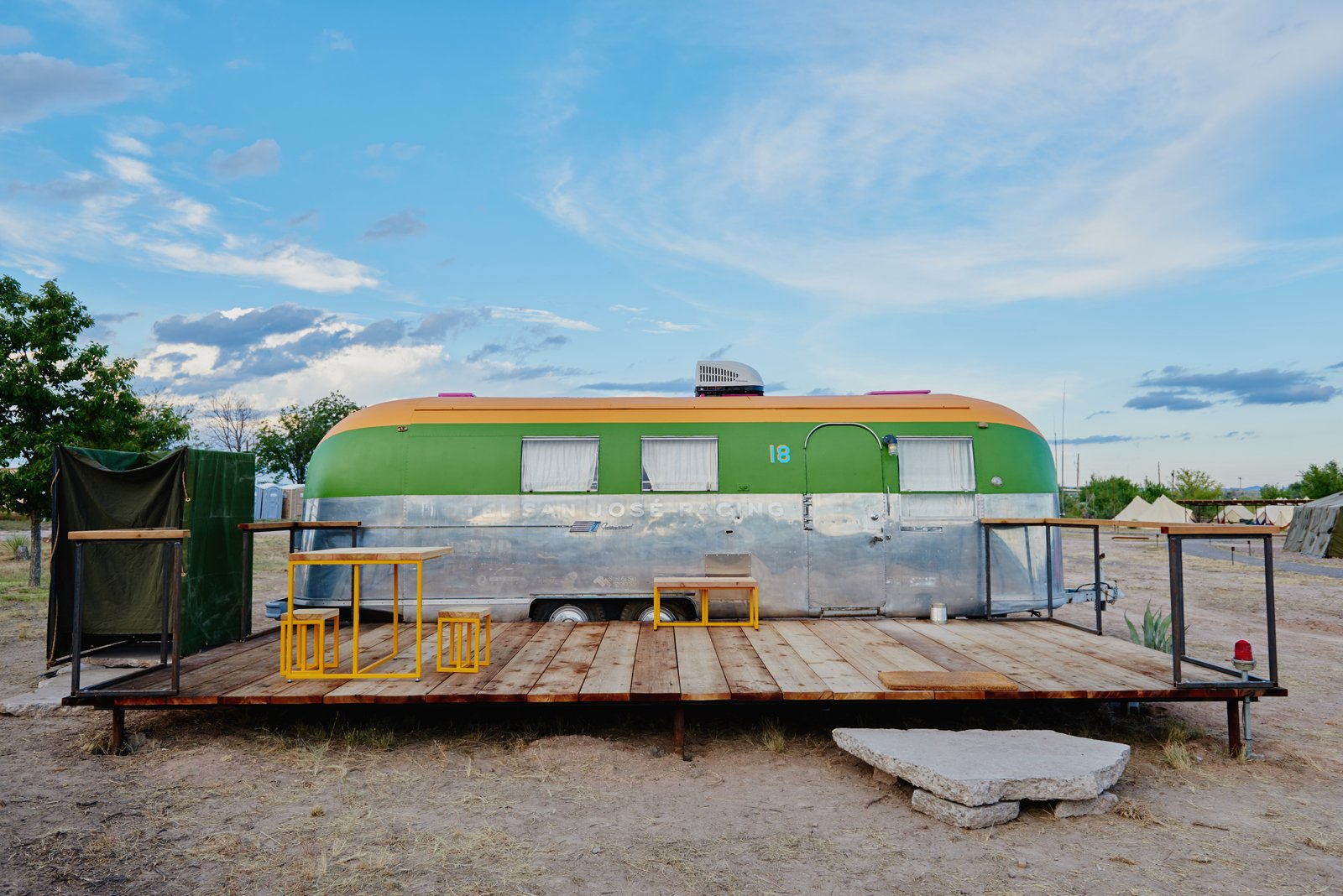 Exterior, Mid-Century Building Type, Camper Building Type, Metal Roof Material, and Metal Siding Material Custom outdoor furniture sits on the decks of each trailer.    Photo 5 of 12 in Let Your Creativity Soar at This Eclectic Hotel With Tents, Tepees, Yurts, and Trailers