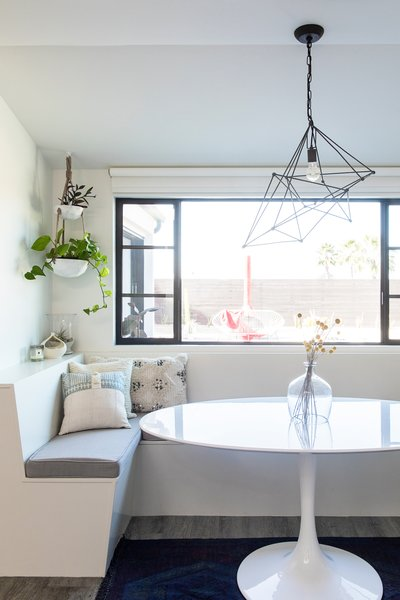 Naber removed a sliding door and installed a four-foot extension in the kitchen to accommodate a stylish breakfast nook that overlooks the patio and backyard.