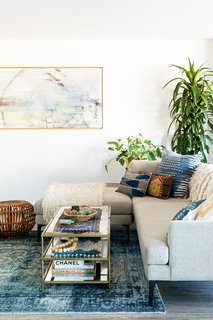 A cozy mix of textures beckons from the living room.