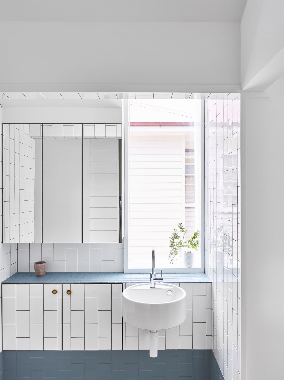 Bath, Ceramic Tile, Wall Mount, Tile, and Subway Tile At the sink area is built-in storage and a floating glass medicine cabinet.    Best Bath Enclosed Wall Wall Mount Ceramic Tile Photos from A Small Australian Cottage Becomes an Airy Gathering Hub