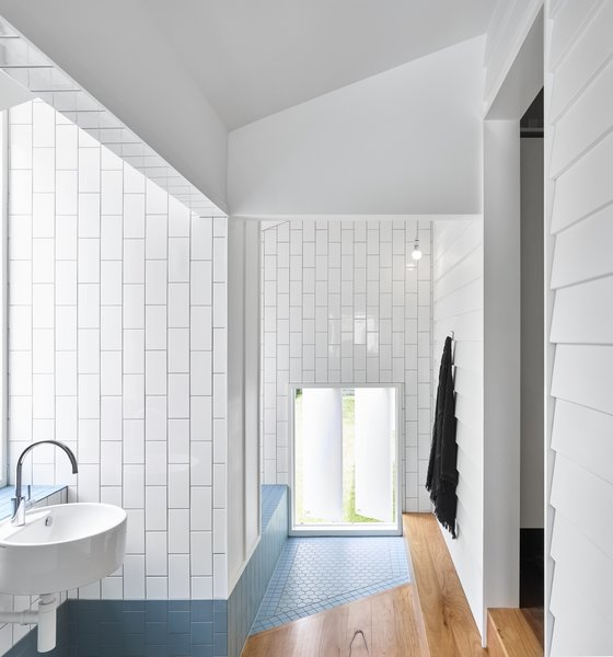 The angled tile floor-pad designates the entrance to the bathtub area.