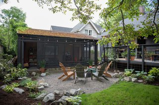 Carstensen landscaped the backyard and added a simple fire pit circle with chairs. He updated the deck, replacing the vertical posts with screens to create a more open feeling.