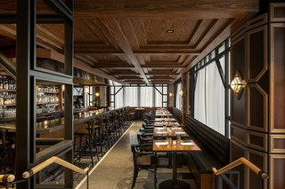 A rosewood coffered ceiling, swanky black banquette, black granite bar, and intricate millwork greet you at Q.