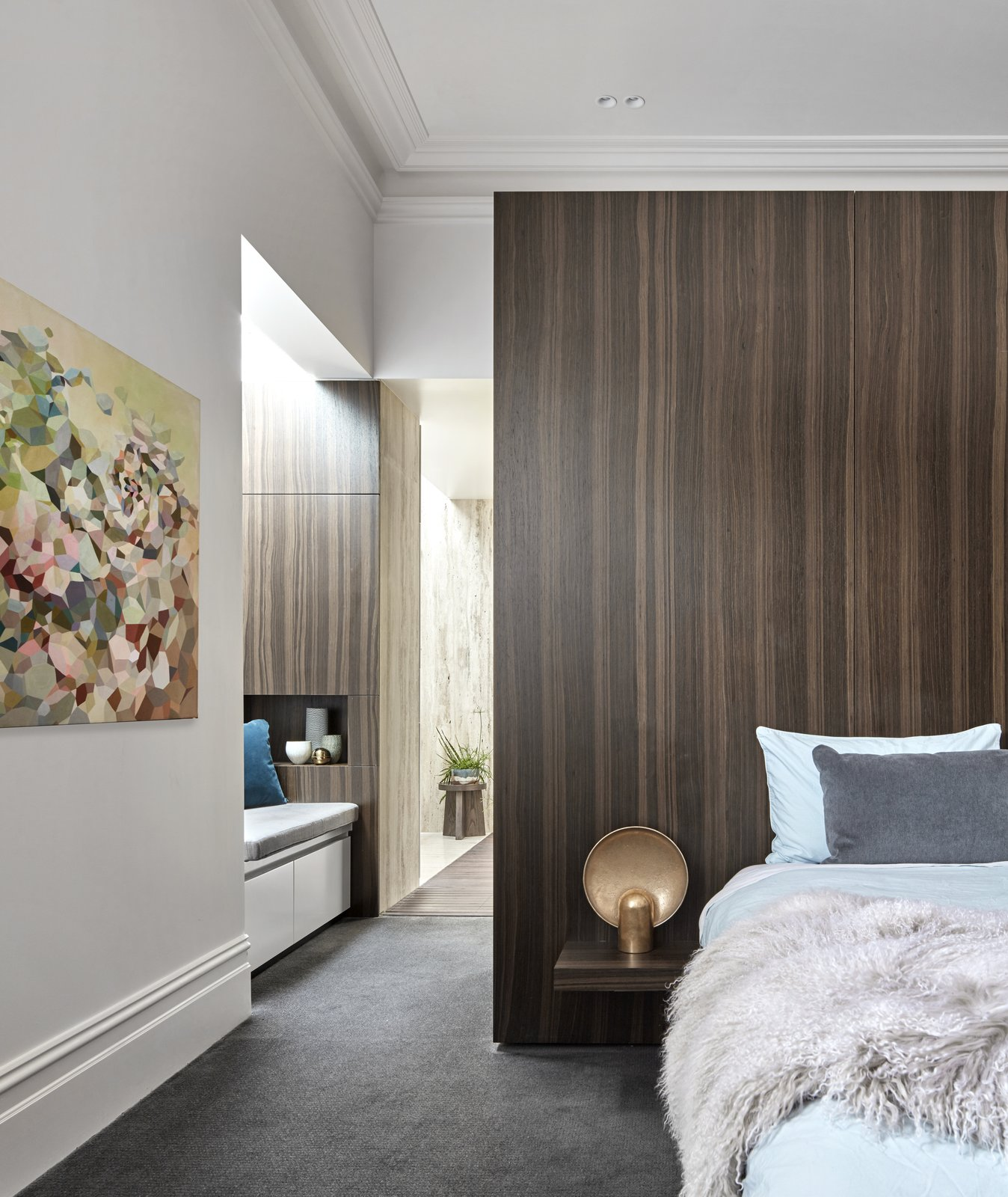 Bedroom, Bed, Night Stands, Carpet, Lamps, Bench, and Recessed Part of the renovation involved creating a master bedroom suite.  Best Bedroom Recessed Bench Night Stands Bed Photos from Courtyards Maximize Sunlight in This Renovated Australian Abode