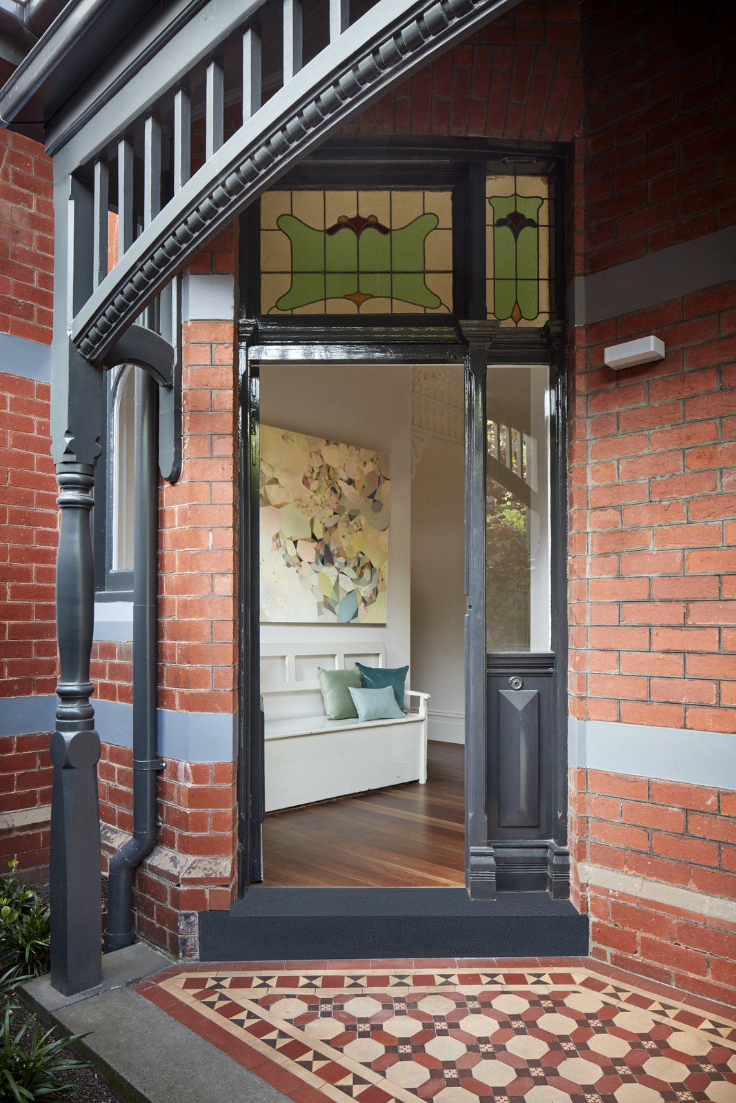 Exterior, Brick Siding Material, and House Building Type Throughout the revamp, charming historical details were kept intact.    Photo 2 of 11 in Courtyards Maximize Sunlight in This Renovated Australian Abode