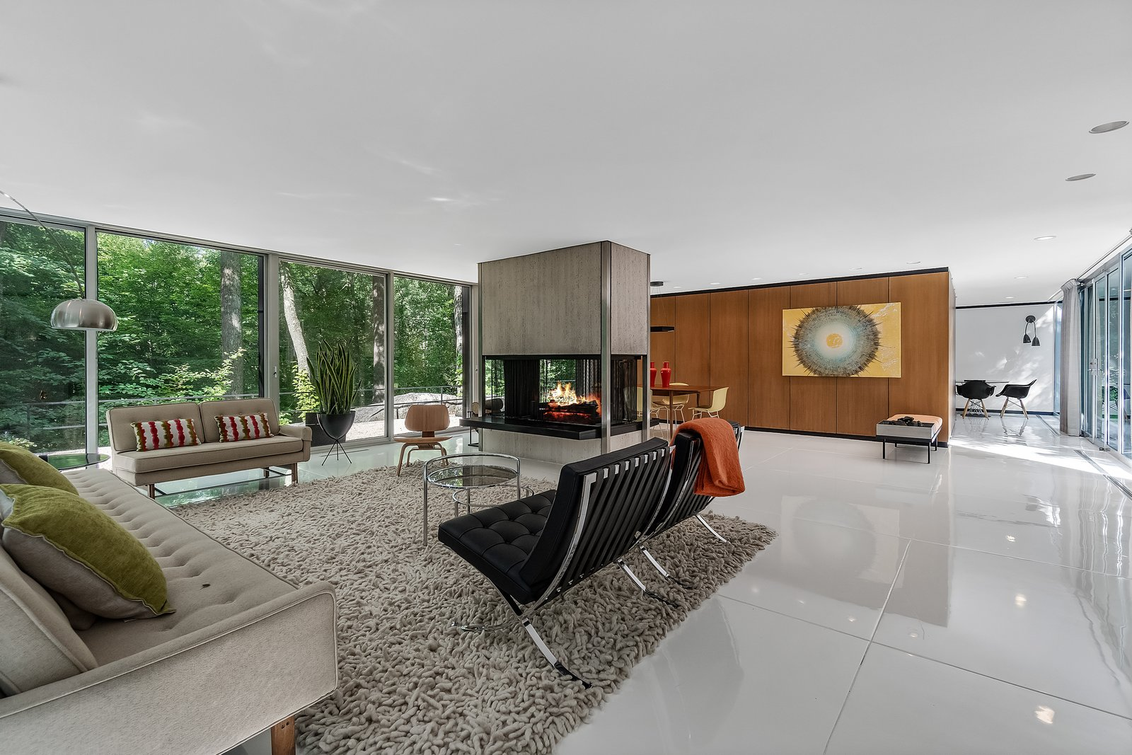 Living, Concrete, Coffee Tables, End Tables, Lamps, Chair, Two-Sided, Recessed, and Sofa In the main living areas, the concrete slab floor was scored and given a coat of white resin.  Best Living Lamps Two-Sided Photos from A Mint Midcentury in New York Asks $2.2M