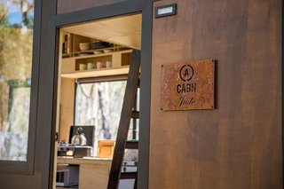 The 148-square-foot CABN is clad in stained Australian timber and suited to the climate.