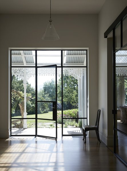Steel-framed openings create new views into the historic garden.