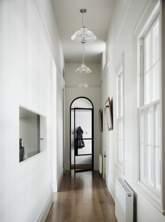 This view shows how the steel-framed glass was elegantly melded with historic architectural details like the arched hallway opening.