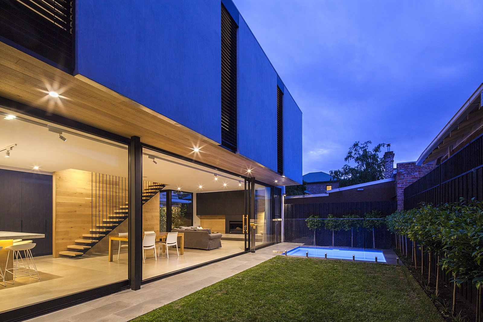 Outdoor, Grass, Small Pools, Tubs, Shower, Side Yard, Back Yard, Walkways, and Trees The architects suggested fitting in a new pool in the yard, much to the delight of the owners' children.  Photo 11 of 11 in A Streamlined Addition Serves a Family of Four in Australia