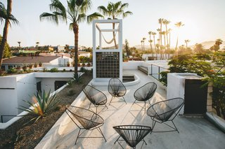 The rooftop lounge overlooks the town square, cathedral, and Sierra Laguna Mountains, and is often used for unplugged concerts. The site's zoning allows for two additional floors, making future development of residential apartments or penthouses possible.
