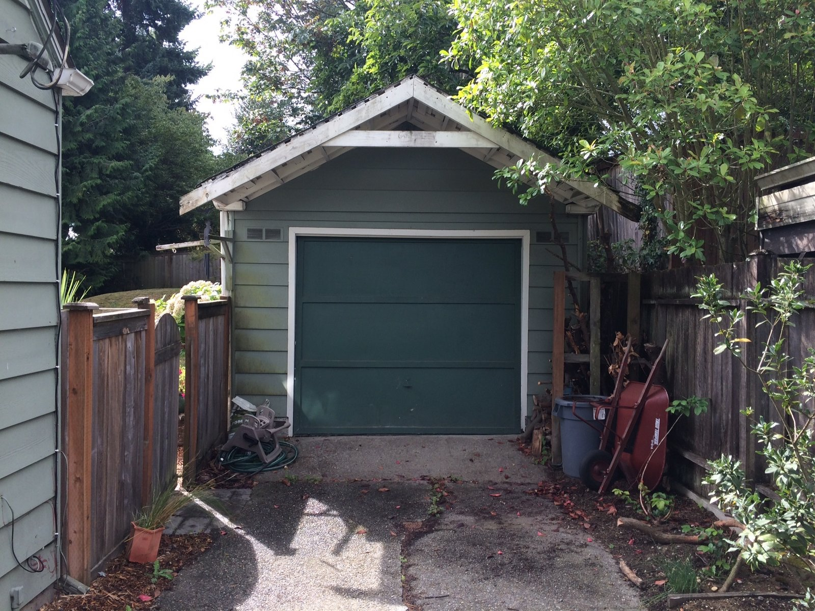 "Before: a view of the street-facing garage door.  Photo 4 of 13 in A Detached Garage Becomes a Winning ""Granny Pad"""