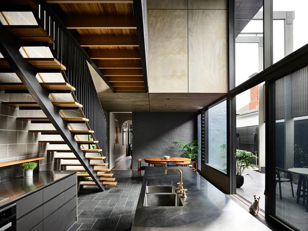 A catwalk connects the two bedrooms upstairs without impeding the flow of light in the main area. The staircase is composed of structural steel with a painted finish, and blackbutt treads and handrail.