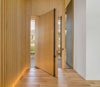 "The ten-by-six-foot solid wood door has a traditional ""waving wood"" pattern to the surface."