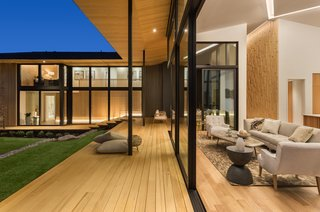 A continuous deck or veranda, called engawa in Japanese, functions as both a step and seat, to seamlessly connect the house to the garden. Deep eaves, or hisashi, provide cover and reflect light from the interior.