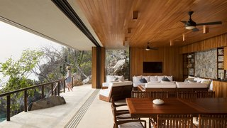 The cedar-clad interior provides protection from the sun and orients views towards the ocean.