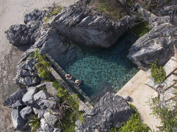 "The firm envisioned the pool as a spot where water floods the stone, ""almost in a way of a pond remaining after the turning tides."""