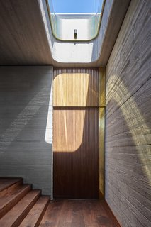 A rounded skylight over the stairs.