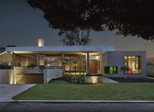 """Said Cownie: """"I felt a responsibility to produce a design for this new house that not only served the needs and desires of my clients but was also in conversation with the ethos of the suburb, without mimicking or replicating the past."""" The strong form of the street-facing facade is fashioned from board-formed concrete, and a solar array is tucked on the roof."""