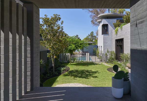 "According to the architects, ""the spatial arrangement of the 'pocket' courtyards is also driven by environmental concerns: the building is teased apart to maximize winter solar penetration and to capture prevailing cooling breezes."""