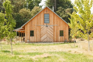 The 1,800-square-foot barn and workshop was designed by architect friend Yianni Doulis. The exterior employs untreated cedar in a reverse board-and-batten style.