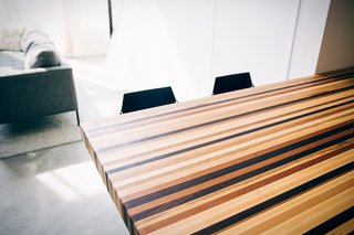 """The peninsula counter was crafted by a local woodworker that the couple met at a craft fair. """"It's a mix of basically every wood under the sun: white oak, mahogany, birch, ash, maple, cherry, walnut, and more,"""" say the couple. """"We love the result thanks to its unique (and practical) style."""""""