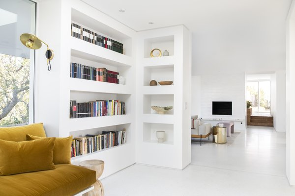 This view shows how the library alcove relates to the nearby family room, and beyond that, the front entry.