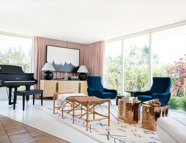 Moore and Goldsmith's priorities for the living room were to play music and listen to records. The piano and AllModern's Brixton sideboard, which holds the vinyl, serves their purposes well.