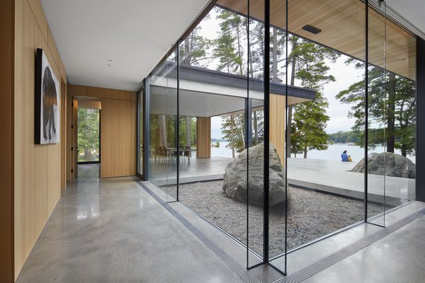 The frames around the glass were kept minimal so as to put the attention on the outdoors. The polished concrete flooring inside merges easily with the courtyard to encourage a sense of indoor/outdoor flow.