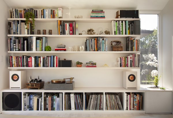A wall of shelving, about seven feet tall and 12 feet wide, keeps reference books and vinyl close at hand. Michael designed and fabricated the speakers, turntable, and amplifier (the latter incorporating another person's circuitry design).