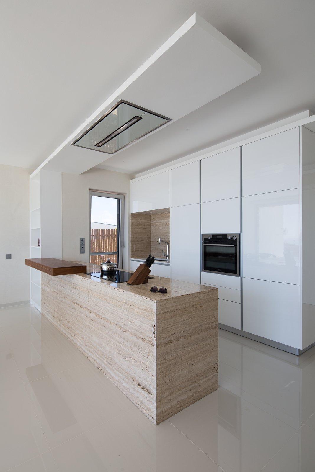 Villa GK kitchen with travertine peninsula