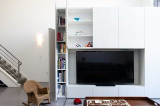 The cabinet depths vary depending on what's being stored, and Knayzeh made sure that there is no wasted space. A niche for the 70-inch television guarantees that the parents can enjoy their hobby of watching movies.