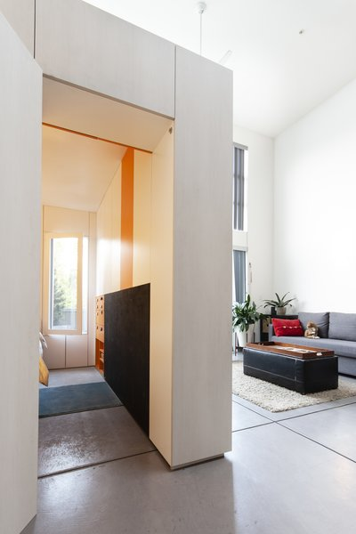 "Knayzeh's favorite detail is ""the flush door which aligns perfectly with the 'window' in the room, and the door to the apartment. Making sure that this object-interface remains self-contained without any hardware sticking out was important."""