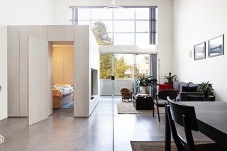 Rather than relocate, architect Rebal Knayzeh devises a flexible, mobile bedroom with built-in storage space.
