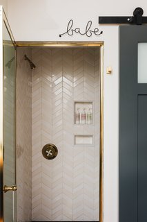 """Idiosyncratic decor touches like the """"babe"""" sign balance traditional detailing."""