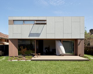 "The house was designed with passive heating and cooling strategies in mind, which are so successful that there is no air conditioning. The thickened wall over the north-facing glass forms an eave, which helps to modulate incoming sunlight in the summer. ""In winter, the sun can penetrate well inside the living and dining rooms, warming the floor slab,"" says the firm. Additionally, ""the double height of the living space provides stack ventilation, with an operable highlight window naturally drawing hot air up and out."" Cross-breezes are encouraged by effective window and door placement."
