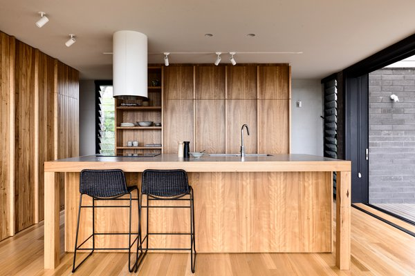 """The kitchen appears as a central bench, acting as social knuckle to the interior space,"" says the firm."