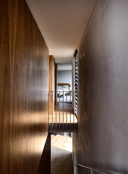 A stairwell leads up to the reconfigured living spaces and principal bedroom on the upper floor.