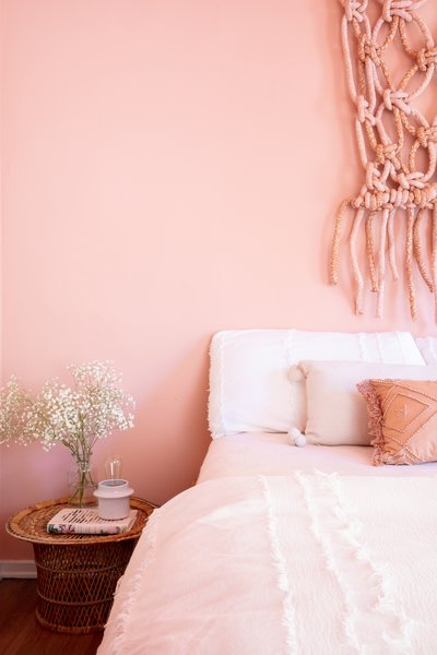 Terra-cotta and rose shades adorn a guest bedroom.