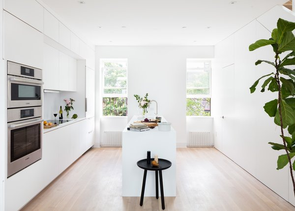 A second modern kitchen with cabinetry by Good Dog Rosie slots seamlessly into the historic shell.